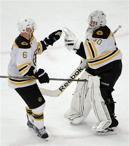 Greg Zanon and Tim Thomas on 4/1/12 against the Rangers