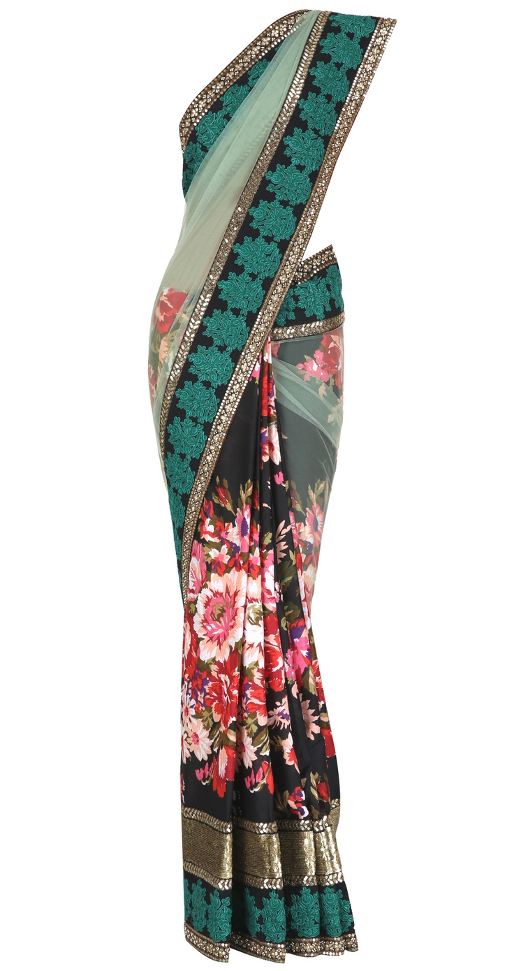 Floral printed cotton saree with a green net pallu and masjid border. It comes with a matching blouse piece in orange two-tone silk by SABYASACHI. Shop at www.perniaspopupshop.com