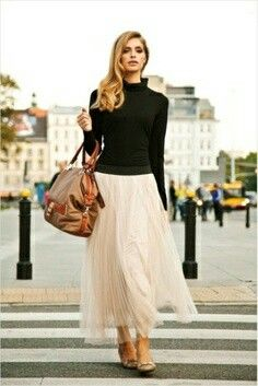 Fitted black cashmere or ballet with flowing skirt. Pixie and glasses.