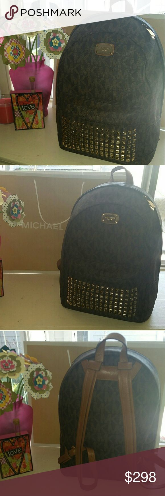 Authentic Michael Kors LG studded backpack Large studded backpack  Brown One outside zipper compartment Five compartments plus one zipper pocket Great for travel Michael Kors Bags Backpacks