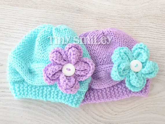I love these because they are the exact colors our nursery will be :)  Twin Mint Green and Lilac Flower Baby Hats Cable by TinySmiley, $32.00