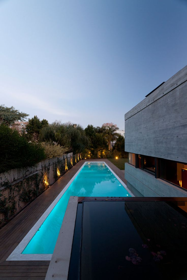 46 futuristic swimming pools - A Concrete House With A Pond And A Green Roof Incorporated Into Its Design