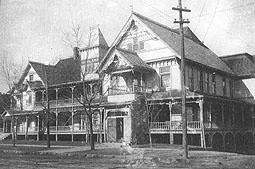 """Built in 1896 by Dr. W. C. Banta and Dr. C.J. Keegan, the Highland sanitorium (note the exchange of the typical """"a"""" with an """"o"""") was an elegant Queen Anne """"home hotel. It boasted 74 guest rooms. by 1921, an extensive brick annex with an interior ramp connecting it the original structure had been constructed, and in 1929 another larger, five-story addition was built. The original frame sanitorium was destroyed by fire on March 11, 1929."""