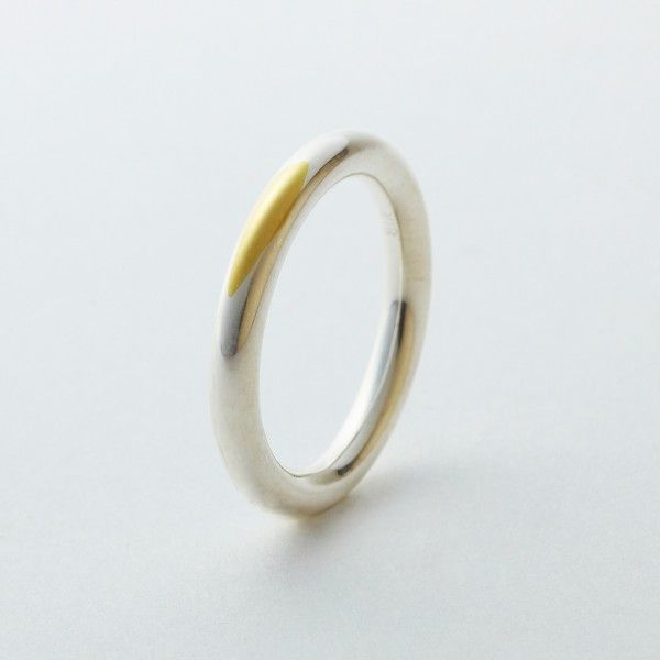 So cool! Silver plated gold wedding ring. Over time the silver wears
