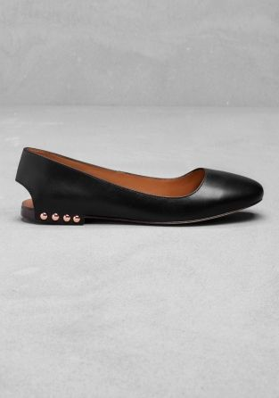 Made from smooth leather, these ballerinas have an open back with a strap attached to the heel with shiny metal studs. A square toe and leather sole complete the style. Heel height: 1.3 cm Platform height: 1 cm.