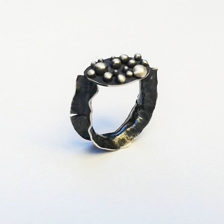 Sterling silver ring with silver drops. Heavily oxidized and distressed on the top and at the edges.