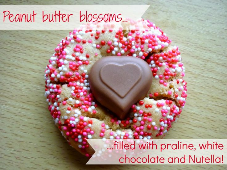 My sugar coated life...: Peanut butter cookies filled with praline centre chocolates, nutella AND white chocolate!