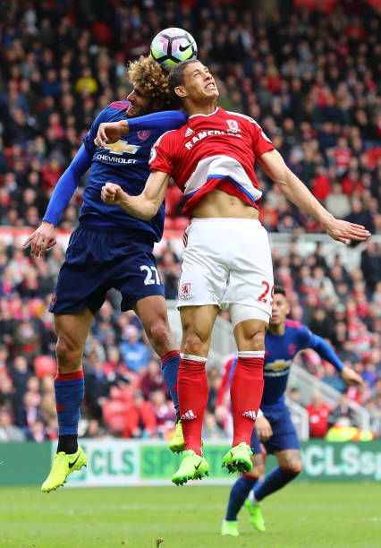 Marouane Fellaini of Manchester United and Rudy Gestede of Middlesbrough battle to win a header during the Premier League match between Middlesbrough...