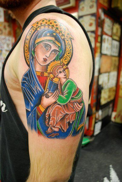I know reddit is no fan of religion but here's my Our Lady of Perpetual Help tattoo anyways. Done by Joel Molina at New Life Tattoos in Champaign, IL : pikdit