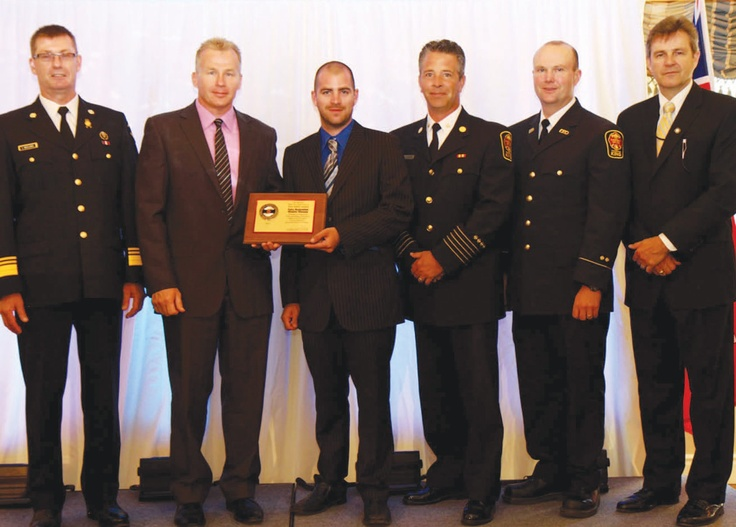Foley Restoration Disaster Kleenup of King was honoured recently for its community contributions. Shown are (l to r) Ted Wieclawek, Ontario Fire Marshal, Adam Tzarik and Brennan Foley of Foley Restoration Disaster Kleenup, King Fire Chief Bryan Burbidge and Keith Wells of King Fire & Emergency Services and Ian Davidson, Deputy Minister of Community Safety with the Ministry of Community Safety & Correctional Services.
