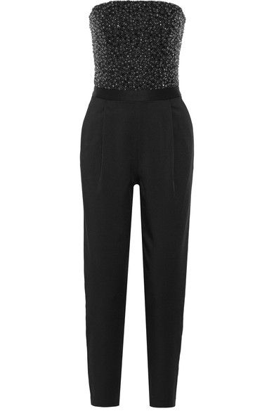 Alice + Olivia's glamorous 'Jeri' jumpsuit is embellished with scores of glistening black beads and crystals. Cut from glossy crepe de chine, this tailored piece has an internal sculpting bodice that falls to a sleek straight-leg silhouette. We think it's a cool alternative to a cocktail dress.