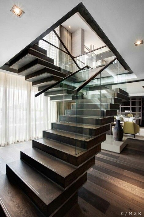 Cool, modern staircase with glass hand rails.
