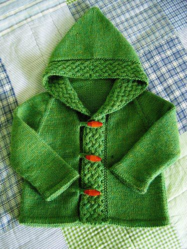 """Description: This toddler cardigan is an adaptation of Kate Gilbert's """"A Cardigan for Arwen"""" from theWinter 2006 Interweave Knits magazine. I resized it for a 12-18 month old, altered the construction to make it a raglan cardigan and added toggle buttons and loops. You will..."""