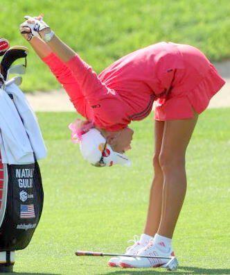 Professional golfer Natalie Gulbis Stretches during a match