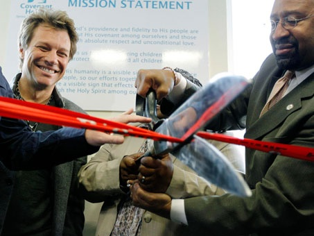 Jon Bon Jovi, left, watches as Mayor Michael Nutter, right, and Cordella Hill, executive director of Covenant House Pennsylvania, mark the opening Tuesday of Covenant House's new facility in Philadelphia. Scroll upScroll down