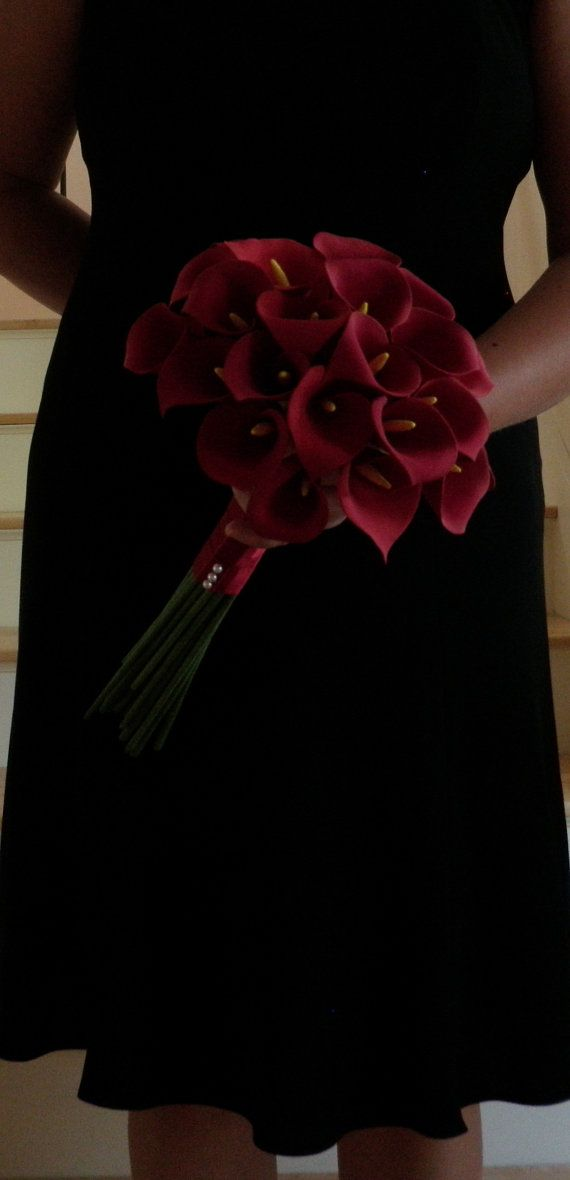 dad's fave but in red! ...so kinda moms fave too lol....Calla Lilly Bridesmaid Bouquet