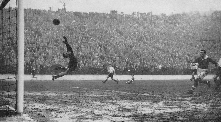 29th December 1956. Sunderland goalkeeper Willie Fraser makes a flying leap but is unable to stop Charlton Athletic inside forward John Ryan from scoring, at the Valley.
