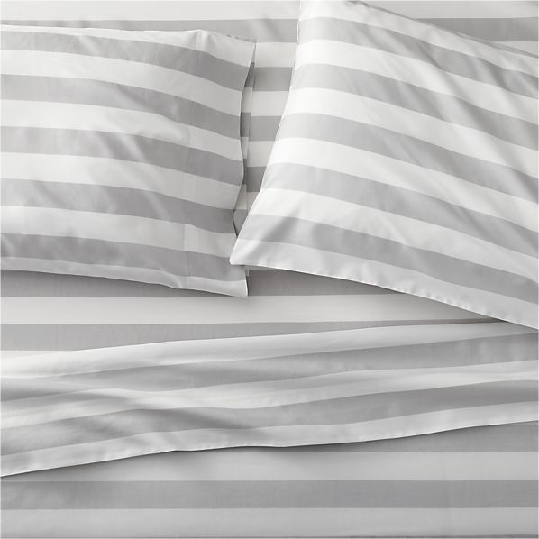 """Crisp stripes in soft grey and white add a breath of fresh air to the bedroom in this fresh design by Finnish designer Aino-Maija Metsola. A tribute to summer, the pattern name translates as """"summer heat"""" although the effect is decidedly cool and fresh. Bed pillows also available."""