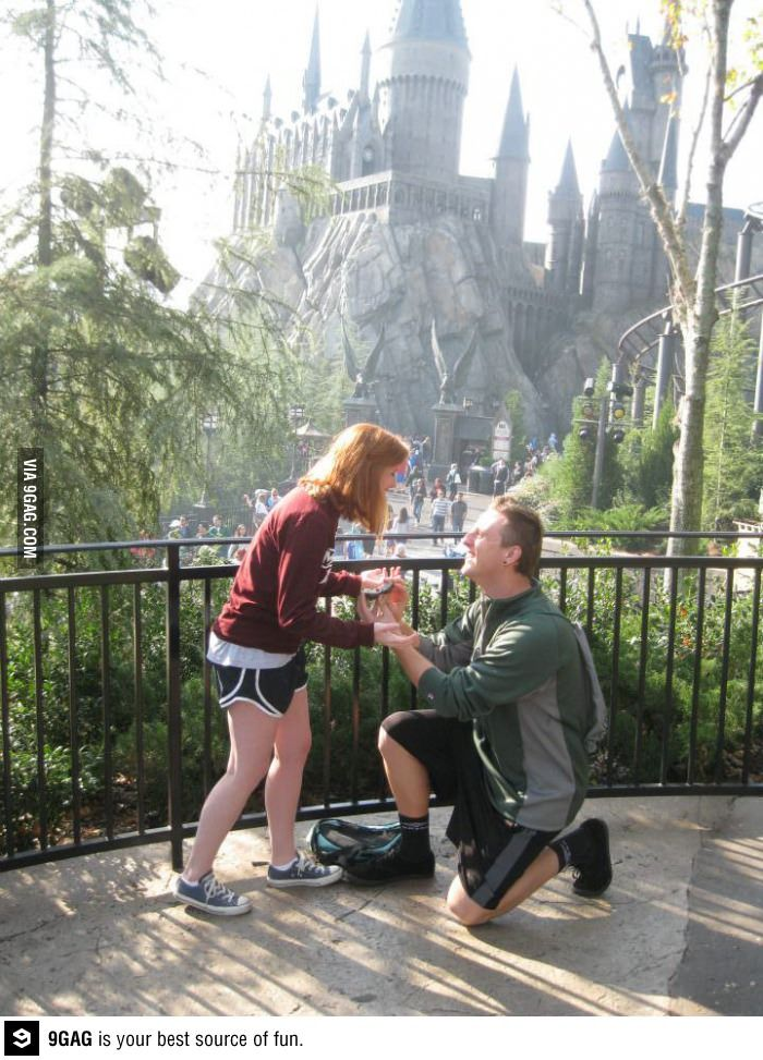 Proposed at Wizarding World of Harry Potter with ring in a handmade Golden Snitch