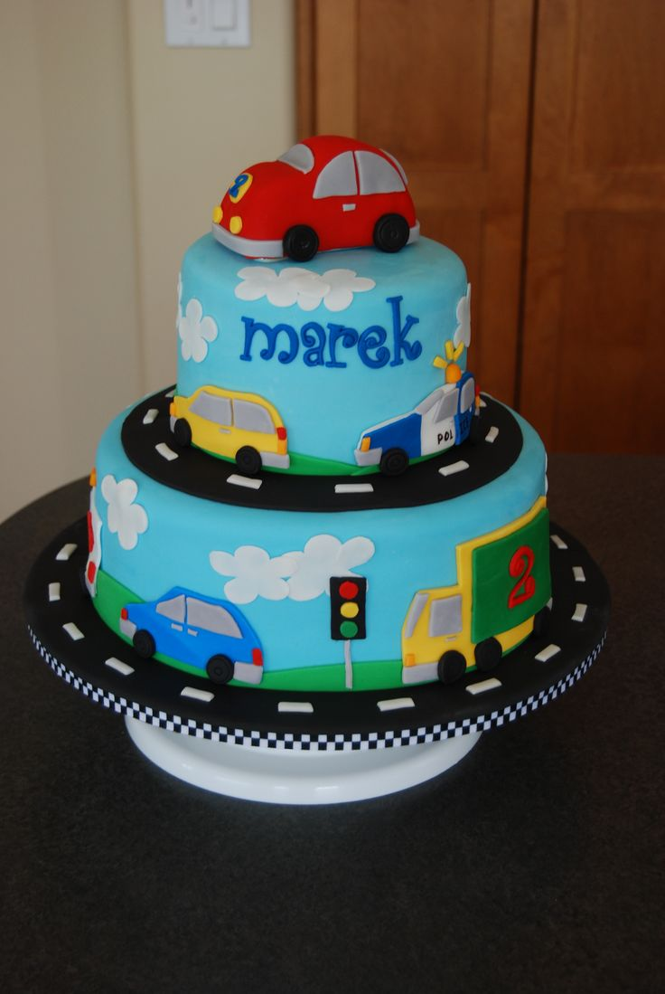 Vehicles Birthday Cake - Made for a little boy who loves anything with wheels.  Top car is RKT, everything else is fondant.  TFL!