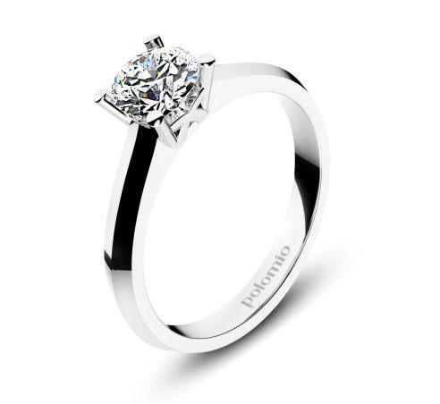 ZÁSNUBNÍ PRSTEN VALENCIA Polomio Jewellery. Optický klam nebo nějaké kouzlo? Kulatý kámen briliantového výbrusu zasazený do čtyř kulatých krapen a zdálky kámen vypadá jako čtverec.....nevěříte? Nechte se okouzlit designem prstenu Valencie a uvidíte. Zásnubní prsten je možné obědnat v červené, růžové, bílé a žluté barvě zlata. Zásnubní prsteny jsou osazeny zirkony, brilianty, nebo moisanity.