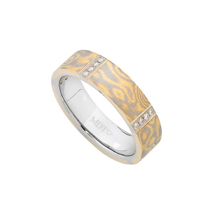 Mokume Gane bands stand for strength as they are made based on a Japanese method of sword making. Features two tone metal (18ct white and yellow or 18ct white and rose gold) to get that unique pattern which varies on every single ring, matching wedding bands can be an interesting option.