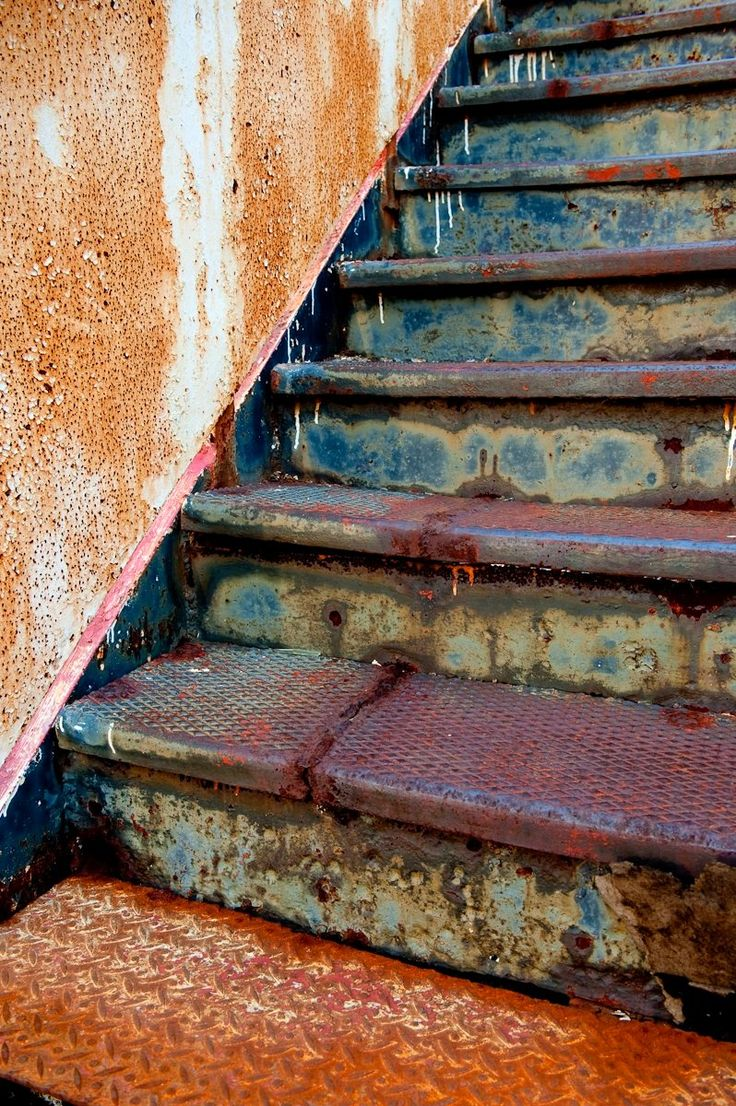 These old, old steps are really rusty stairs leading to who-knows-where.  Wonder where ... do you?