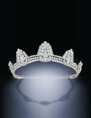 A superb Art Deco diamond tiara by Cartier. Composed of five graduated shield shaped clips, each tapered brilliant and baguette-cut diamond panel raised on the similarly-set diamond frame, circa 1930, with five detachable clip fittings, one brooch fitting and a cuff bangle, one diamond deficient. This tiara formerly belonging to Maureen Ward, Countess of Dudley, nee actress Maureen Swanson.