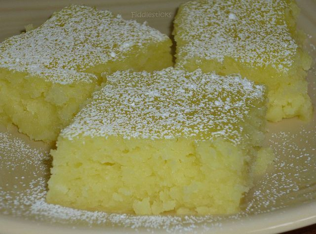 Two Ingredient Lemon Bars: 1 box angel food cake mix 2 cans lemon pie filling (total of 42 oz) Mix.  Bake 350 for 25 minutes Cool on wire rack and sprinkle with powered sugar