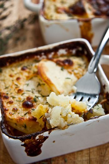 In South Africa this is called Potato Bake...perfectly cooked potatoes in a creamy cheesy sauce, baked until crisp on top and deliciously oozy inside.