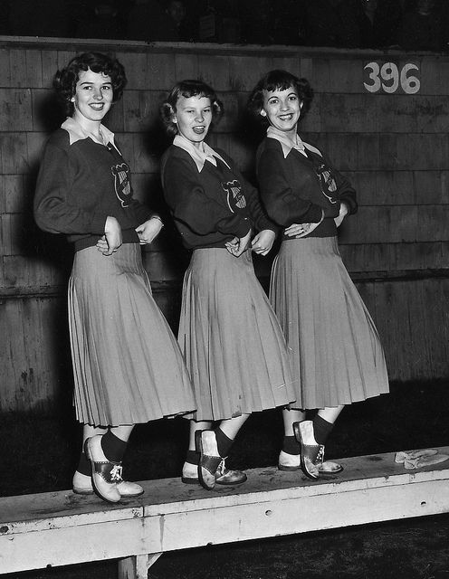 Long skirted 1940s cheerleader outfits, girls, females, photo, black and white, history, cheerfull. Cute outfits!!