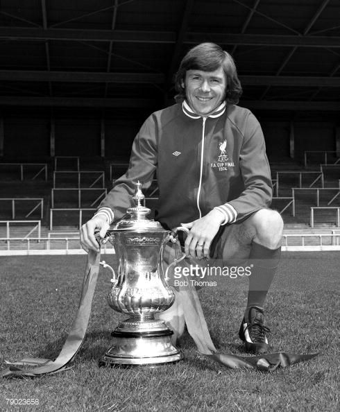 Sport Football England August 1974 Liverpool FC Photocall Liverpool FC's Brian Hall is pictured with the FA Cup trophy that his side won against Newcastle United