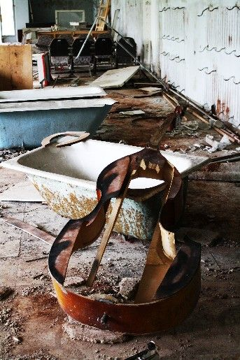 An abandoned cello in Pripyat, after the Chernobyl disaster.