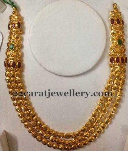 Jewellery Designs: Polki Layers Set with Motifs