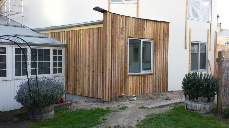 sometimes I love being a builder cypress pine cladding going on looking good