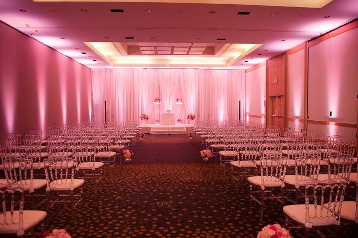 Modern ballroom wedding ceremony with pink uplighting at Westin Arlington (Naomi Lynn Photography)