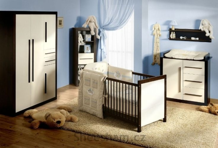 Classy nursery design with color palette limited to light blue, off-white, and dark brown.  Several adorable plush animals are just enough to make this nursery look warm and inviting.