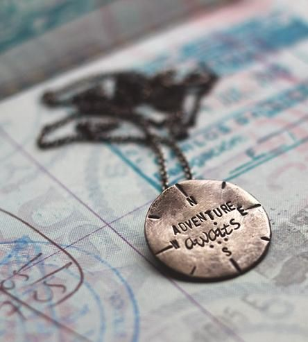 "This hand-stamped necklace serves as an inspirational reminder that new endeavors are often the most exciting. The round sterling silver charm features a compass design with the message, ""Adventure awaits,"" stamped in the center. Consider it a good luck charm on international travels, when starting a new job or otherwise moving into uncharted territory."