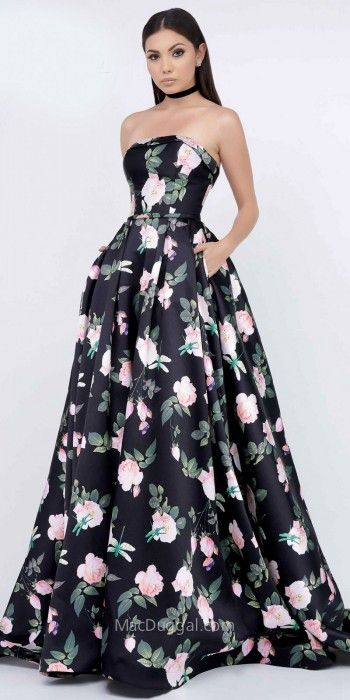 You will not go unnoticed in the unforgettable and striking A-Line Strapless Floral Printed Mikado Ball Gown by Mac Duggal. This classic ball gown features a strapless neckline, a low back and an invisible zipper down the center. The A-line silhouette also includes printed mikado fabric, side pockets, a pleated skirt and a sweep train. #edressme