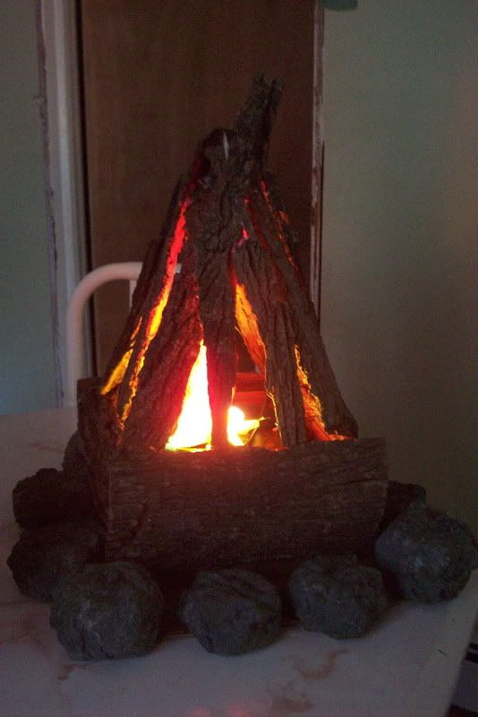 Great indoor campfire idea styrofoam rocks silk flames for Small fake fireplace