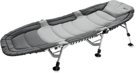 REI Comfort Cot Not your typical, bare-bones camping cot, ours is fully padded, providing plush support with plenty of room to stretch out, relax and slumber until the sun comes up.