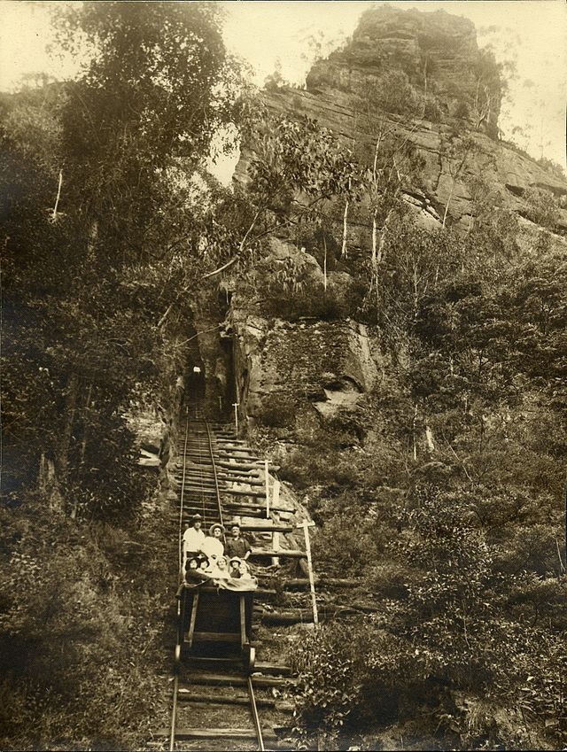 """Tourists ride in a coal skip on the """"scenic railway"""", Katoomba 1915 photo by Harry Phillips"""