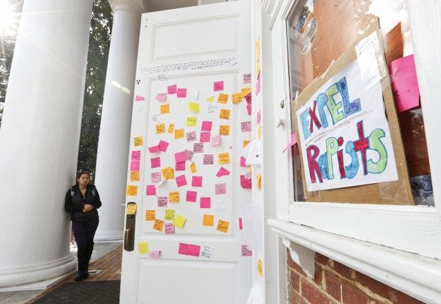 The door of a UVA dorm covered with Post-It notes related to the Phi Kappa Psi gang rape allegations