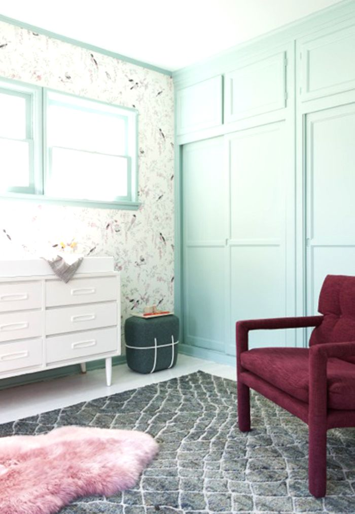Mint green walls and wallpaper in nursery