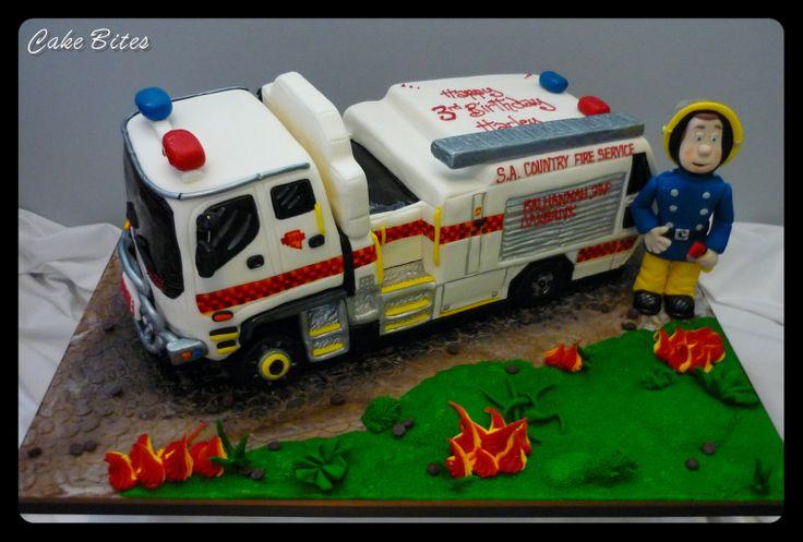 CFS vanilla firetruck cake with a hand modelled fireman Sam