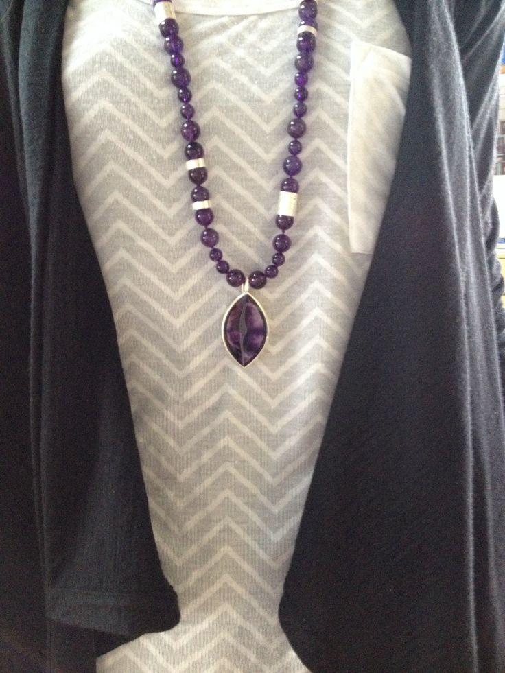 Amethyst necklace with sterling barrels and eye shaped removable centerpiece.