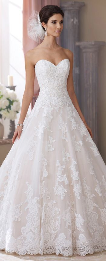 This strapless taffeta ball gown wedding dress with a sweetheart neckline features hand-beaded corded lace, a curved back bodice, and a scalloped hemline.