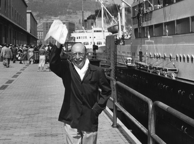 Happy on a boat. Happy with his ticket.