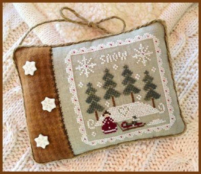 Snowy Winter is the title of this cross stitch pattern from Little House Needleworks that is stitched with Classic Colorworks