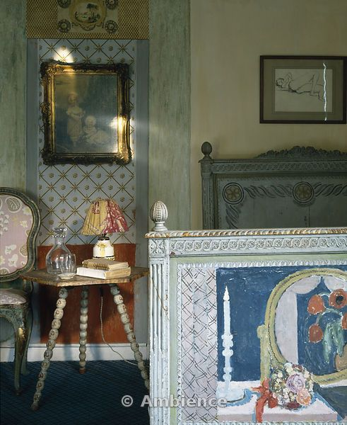 Clive Bell's bedroom at Charleston. The bed was decorated by Vanessa Bell.